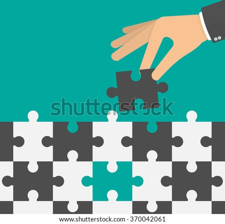 Hand holding or inserting the missing puzzle piece. Solution and problem solving concept. Flat design