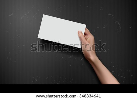 Hand holding paper on black background - stock vector