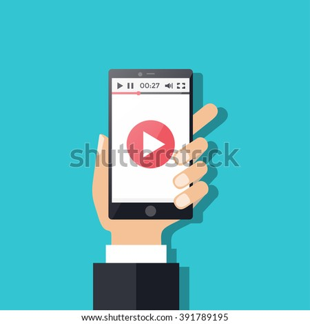Hand holding Smart phone or Mobile phone with with video player on the screen. Movie app  concept. Vector flat illustration - stock vector