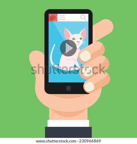 Hand holds black smartphone with open video app and cat on screen. Viral marketing concept.Trendy graphic design elements. Modern creative vector flat illustration. Isolated on trendy green background
