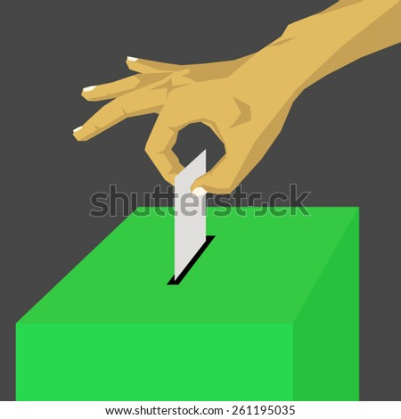 Hand inserting a paper ballot voting on a green ballot box