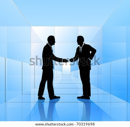 Hand shaking businessmen inside glass building