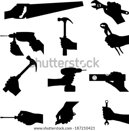 Handed construction tools - vector silhouette