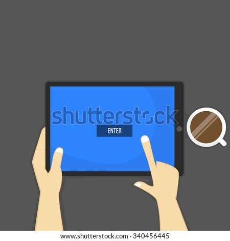 Hands holding tablet, enter button