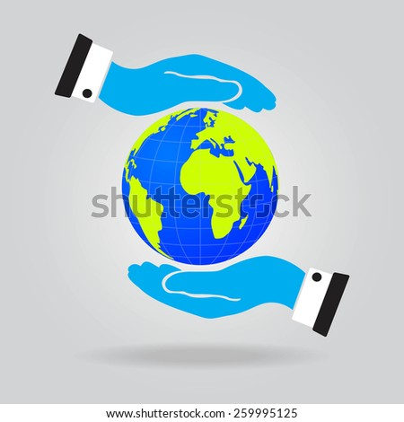 Hands of businessman holding a green earth