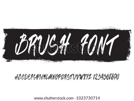 Handwritten script font hand drawn brush stock photo photo vector