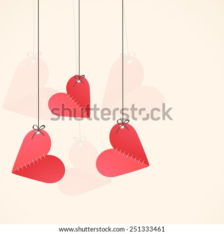 Hanging paper folded red hearts with space for your wishes for Happy Valentine's Day celebration.
