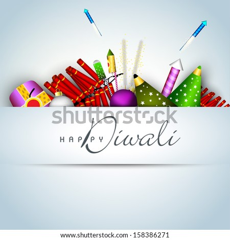 Happy Diwali celebration background or greeting card with colorful firecrackers on blue.