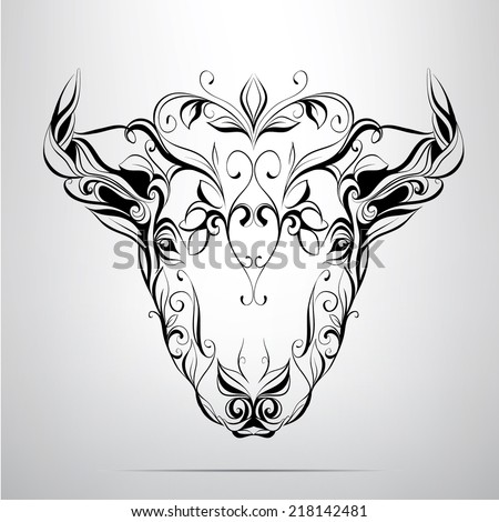 Head of bull in the ornament - stock vector