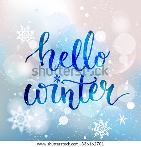 Hello winter text. Brush lettering at blue winter background with snowflakes and bokeh lights. Vector card design with custom calligraphy - stock vector