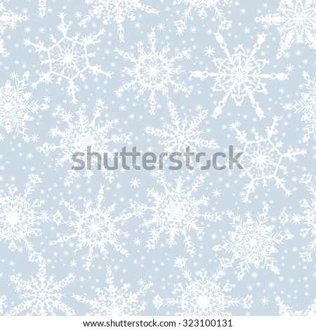 Holiday Wallpaper. Christmas and New Year background. Winter endless background. Snowflakes seamless pattern. White snowflakes on light blue background. Snowfall.