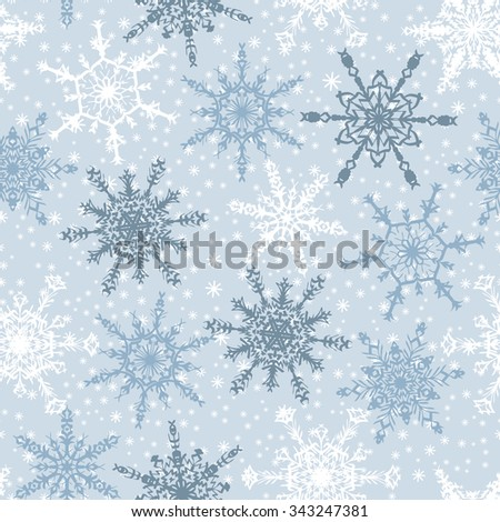 Holiday Wallpaper. Christmas and New Year background. Winter endless background. Snowflakes seamless pattern. White and blue snowflakes on light blue background. Snowfall.