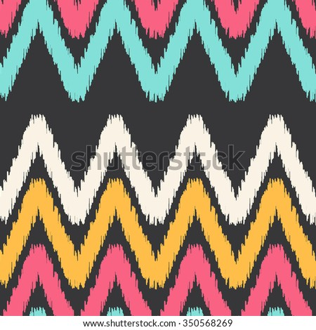Ikat vector seamless pattern with ethnic and tribal motifs, zigzag lines, hand drawn lines. Colorful retro ethnic style seamless background. Vintage print perfect for home textile or fall fashion