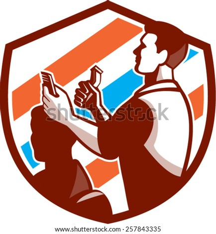 Illustration of a barber holding scissors and comb cutting hair facing side set inside shield crest done with barber pole color in the background done in retro style.  - stock vector
