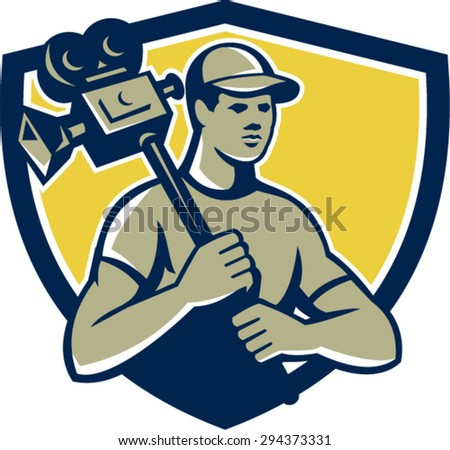 Illustration of a cameraman movie director hodling vintage movie film camera on shoulder set inside shield crest on isolated background done in retro style.