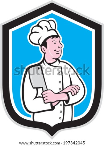 Illustration of a chef cook holding knife arms crossed facing side set inside shield crest on isolated background done in cartoon style.