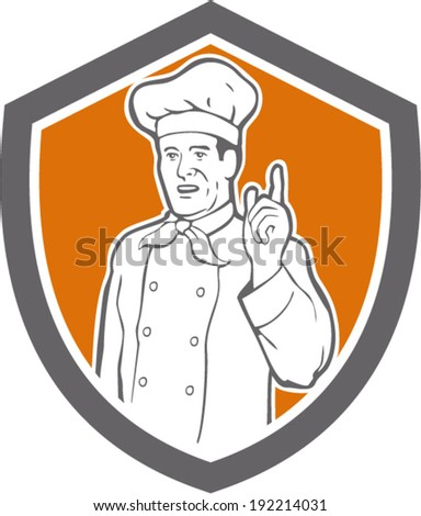 illustration of a chef, cook or baker with hand pointing up viewed from front set inside shield done in retro style on isolated background.