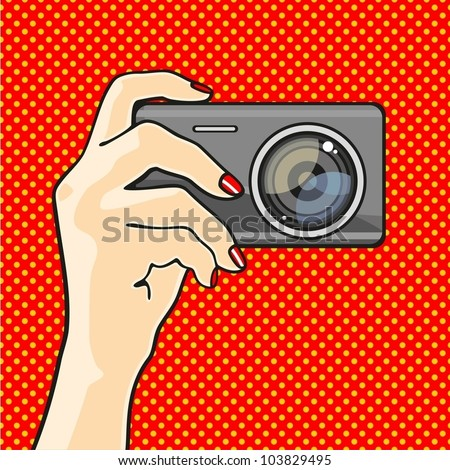Illustration of a hand holding a photo camera - stock vector