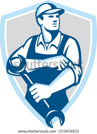 Illustration of a mechanic wearing hat holding spanner wrench rolling sleeve looking to the side set inside shield crest on isolated background done in retro style. - stock vector
