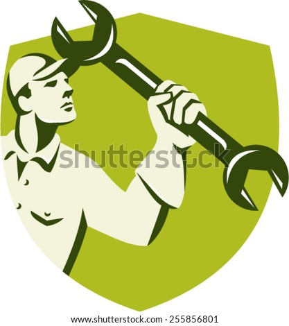 Illustration of a mechanic wielding holding spanner wrench looking up viewed from side set inside shield crest on isolated background done in retro style.  - stock vector