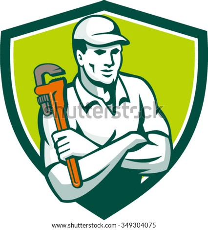 Illustration of a plumber arms crossed holding monkey wrench viewed from front set inside shield crest on isolated background done in retro style.  - stock vector