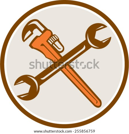 Illustration of a plumber's monkey wrench and mechanic's spanner crossed set inside circle on isolated white background done in retro woodcut style. - stock vector
