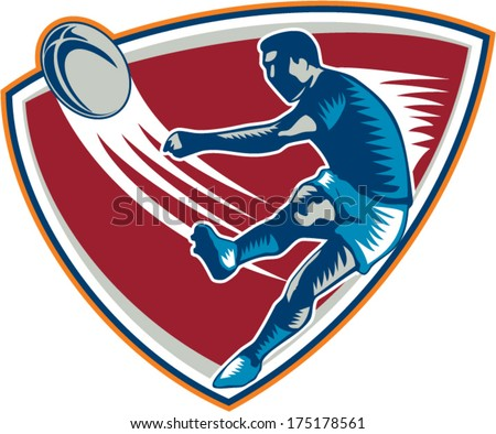 Illustration of a rugby player kicking ball front view set inside shield on isolated background done in retro woodcut style. - stock vector