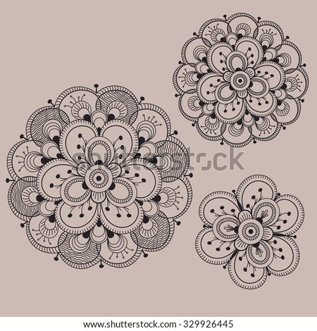 Illustration of a set of three decorative flowers in black color on a brown background