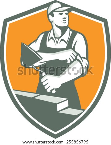 Illustration of a tiler plasterer mason masonry construction worker with trowel rolling sleeve looking to the side set inside shield done in retro style.  - stock vector