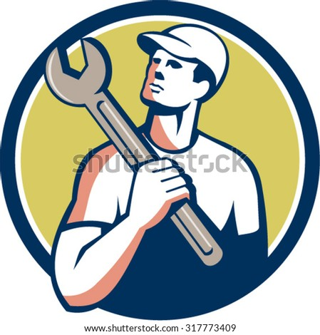 Illustration of a tradesman mechanic wearing hat holding spanner on shoulder looking up to the side set inside circle on isolated background done in retro style.  - stock vector