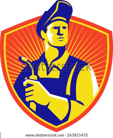 Illustration of a welder holding welding torch equipment viewed from front set inside shield with sunburst done in retro style.