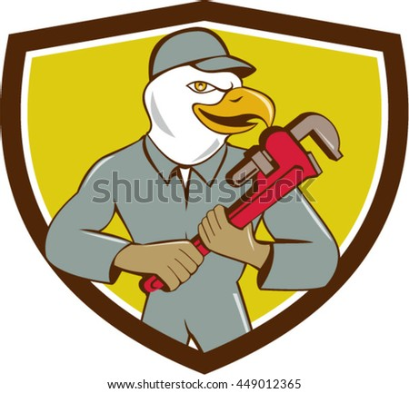 Illustration of an american bald eagle plumber holding monkey wrench looking to the side set inside shield crest done in cartoon style.