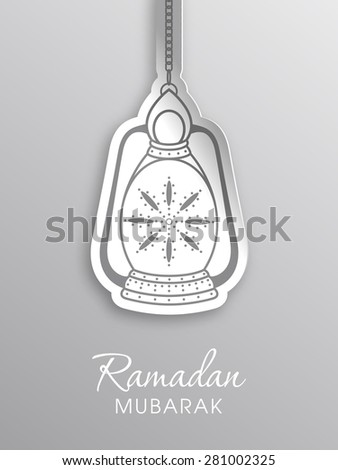 Illustration of Ramadan Mubarak with intricate Arabic lamp for the celebration of Muslim community festival.