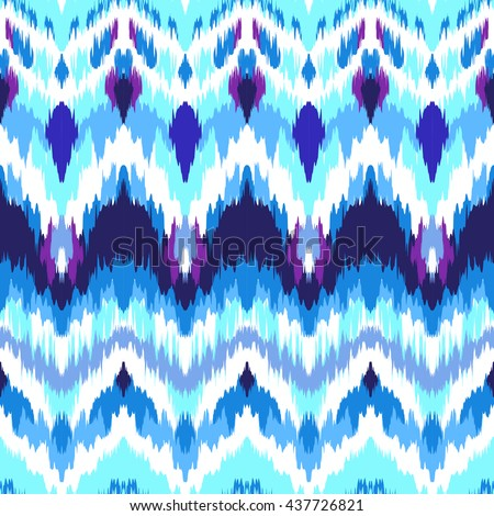 Impressive fashion print. Modern look of ethnic indian ornaments. Seamless pattern in bright blue colors. Tie dye effect and boho chic style. Creative hippies textile.  - stock vector