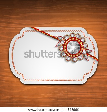 Indian festival Raksha Bandhan background with beautiful rakhi and blank note for your message. - stock vector