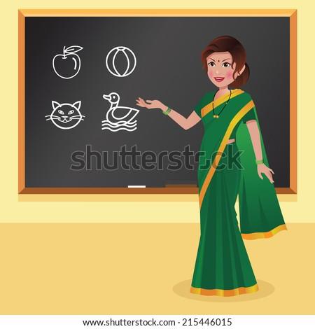 Indian preschool teacher in a green saree in front of blackboard - stock vector
