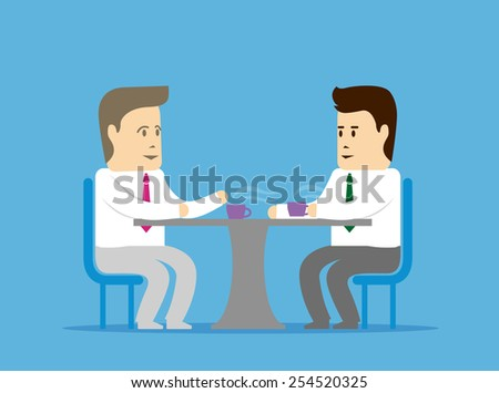 Interview or conversation. Two people talking at the table and drink coffee