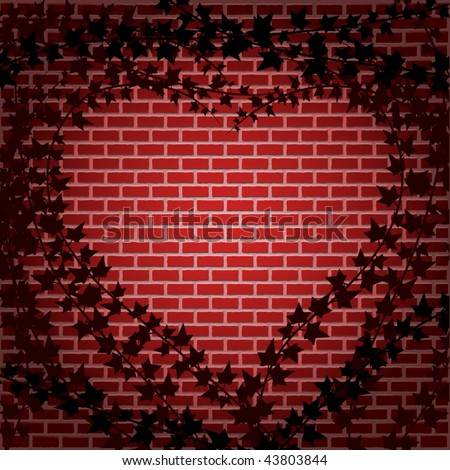 Ivy forms a heart shaped frame against brick wall