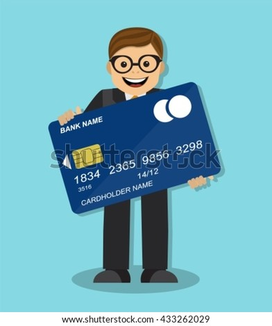 joyful businessman standing and holding a credit card