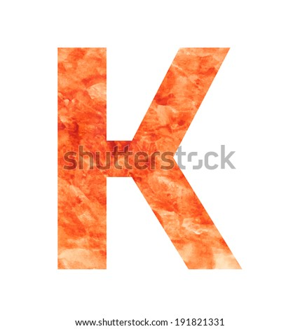 k letter with texura shaped brown earth or stone