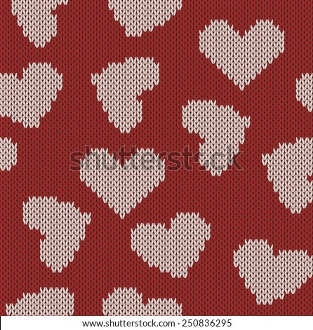 Knitted background with the image of hearts. Valentine's Day