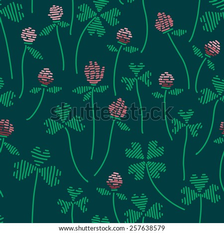 Knitted natural seamless pattern. Vector illustration with clovers leaves and flowers  - stock vector