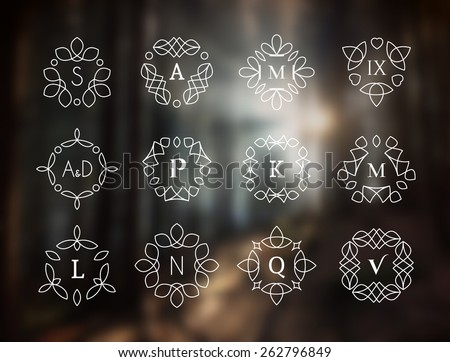 Line art logo template set. Vector monogram symbols on blurred background - stock vector