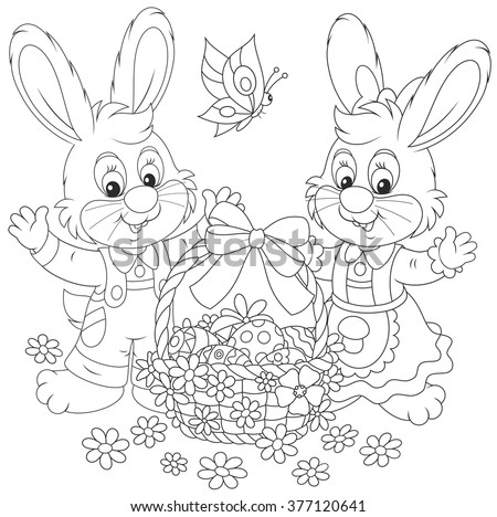 Little bunnies and a decorated Easter basket with painted eggs and flowers