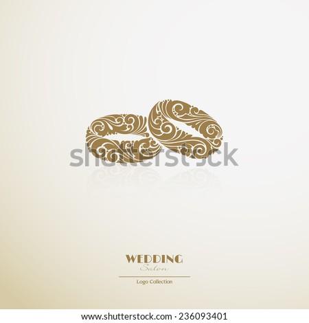Logo wedding salon. Ornate couple of rings icon - stock vector
