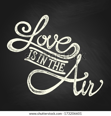 Love is in the air - Hand drawn quotes, white on blackboard