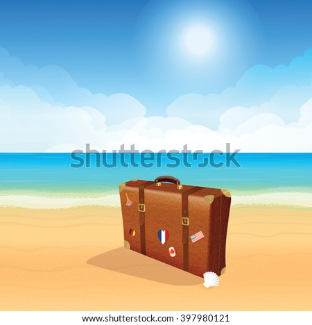 Luggage with traveling stickers at the beach.