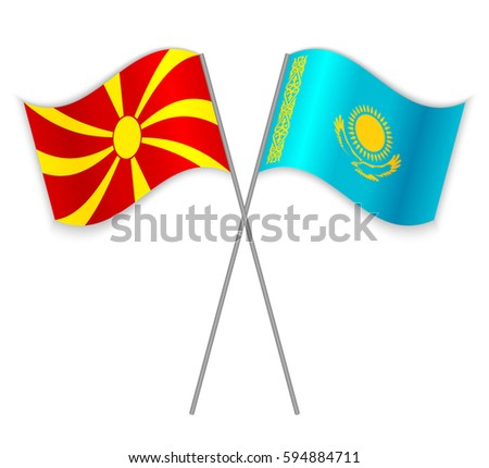Macedonian and Kazakh crossed flags. Macedonia combined with Kazakhstan isolated on white. Language learning, international business or travel concept.