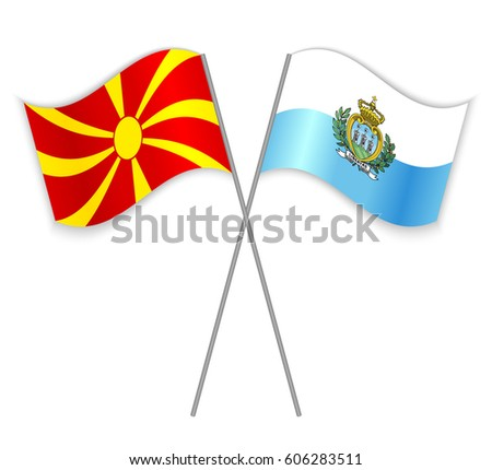 Macedonian and Sammarinese crossed flags. Macedonia combined with San Marino isolated on white. Language learning, international business or travel concept.