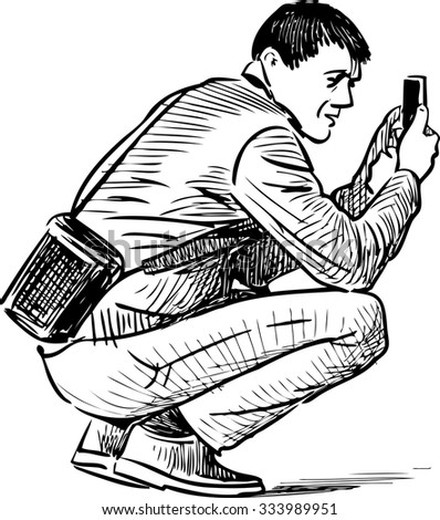 man takes picture on a mobile phone
